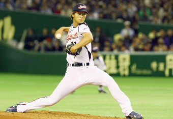 TOKYO - FEBRUARY 28:  Pitcher Yu Darvish #11 of Japan throws a pitch during a friendly match between Japan and Saitama Seibu Lions at Tokyo Dome on February 28, 2009 in Tokyo, Japan.  (Photo by Junko Kimura/Getty Images)