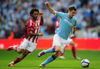 LONDON, ENGLAND - MAY 14: Adam Johnson (R) of Manchester City holds off Jermaine Pennant (L) of Stoke City during the FA Cup sponsored by E.ON Final match between Manchester City and Stoke City at Wembley Stadium on May 14, 2011 in London, England. (Photo