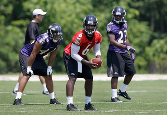OWINGS MILLS, MD - JULY 29: Quarterback Tyrod Taylor#6 of the Baltimore Ravens runs a play during training camp on July 29, 2011 in Owings Mills, Maryland.  (Photo by Rob Carr/Getty Images)