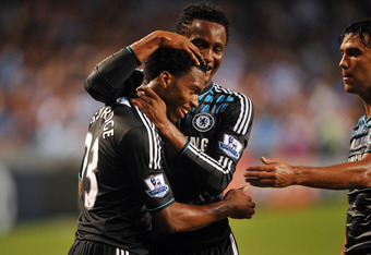 SO KON PO, HONG KONG - JULY 27:  Daniel Sturridge of Chelsea is congratulated by John Obi Mikel after scoring during the Asia Trophy pre-season friendly match between Kitchee and Chelsea at Hong Kong Stadium on July 27, 2011 in So Kon Po, Hong Kong.  (Pho