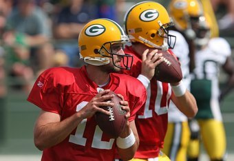 GREEN BAY, WI - AUGUST 03: Aaron Rodgers #12 and Matt Flynn #10 of the Green Bay Packers drop back to pass during practice at summer training camp on August 3, 2009 at the Ray Nitschke Field in Green Bay, Wisconsin. (Photo by Jonathan Daniel/Getty Images)