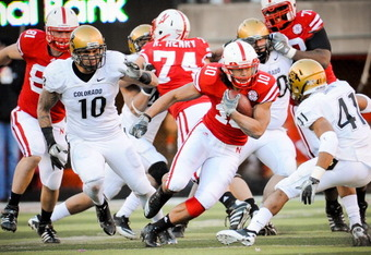 LINCOLN, NE - NOVEMBER 26: Roy Helu Jr. #10 of the Nebraska Cornhuskers weaves his way though the Colorado Buffalo defense during their game at Memorial Stadium on November 26, 2010 in Lincoln, Nebraska. Nebraska defeated Colorado 45-17 (Photo by Eric Fra