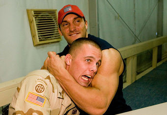 Chris Masters pals around with a soldier in Afghanistan.