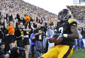 IOWA CITY, IA - OCTOBER 30: Wide receiver Marvin McNutt Jr. #7 of the University of Iowa Hawkeyes smiles as he scores a touch down against the Michigan State Spartans during the second half of play at Kinnick Stadium on October 30, 2010 in Iowa City, Iowa