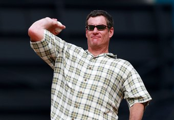 MIAMI - MARCH 31:  Jeff Conine, formerly of the Florida Marlins, throws out the first pitch of the game against the New York Mets on Opening Day at Dolphin Stadium on March 31, 2008 in Miami, Florida. Conine announced prior to the game that he is retiring