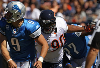 CHICAGO - SEPTEMBER 12: Julius Peppers #90 of the Chicago Bears pressures Matthew Stafford #9 of the Detroit Lions during the NFL season opening game at Soldier Field on September 12, 2010 in Chicago, Illinois. The Bears defeated the Lions 19-14. (Photo b