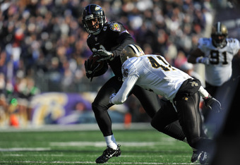 BALTIMORE, MD - DECEMBER 19:  Ed Dickson #83 of the Baltimore Ravens runs in for a touchdown against the New Orleans Saints  at M&T Bank Stadium on December 19, 2010 in Baltimore, Maryland. The Ravens lead the Saints at the half 21-14. (Photo by Larry Fre