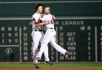 BOSTON, MA - AUGUST 08:  Josh Reddick #16 of the Boston Red Sox is congratulated by teamamte Dustin Pedroia #15 after Reddick hit an RBI single to win the game on August 8, 2011 at Fenway Park in Boston, Massachusetts.The Boston Red Sox defeated the New Y