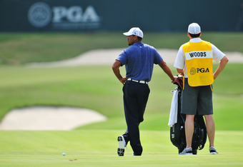 JOHNS CREEK, GA - AUGUST 12: Tiger Woods and caddie Bryon Bell look on from the ninth fairway during the second round of the 93rd PGA Championship at the Atlanta Athletic Club on August 12, 2011 in Johns Creek, Georgia.  (Photo by Stuart Franklin/Getty Im