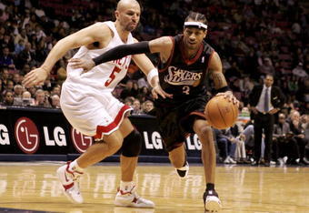 EAST RUTHERFORD, NJ - DECEMBER 10:  Allen Iverson #3 of the Philadelphia 76ers drives past Jason Kidd #5 of the New Jersey Nets during their game at Continental Airlines Arena on December 10, 2005 in East Rutherford, New Jersey.The Sixers defeated the Net