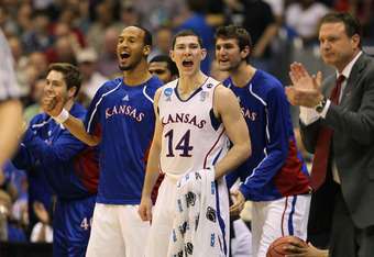 SAN ANTONIO, TX - MARCH 25:  Tyrel Reed #14 of the Kansas Jayhawks celebrates from the bench during the southwest regional of the 2011 NCAA men's basketball tournament against the Richmond Spiders at the Alamodome on March 25, 2011 in San Antonio, Texas.