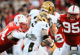 LINCOLN, NE - NOVEMBER 26: Jared Crick #94 and Pierre Allen #95 of the Nebraska Cornhuskers zero in on for Rodney Stewart #5 of the Colorado Buffaloes during their game at Memorial Stadium on November 26, 2010 in Lincoln, Nebraska. Nebraska defeated Color