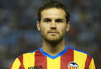 VALENCIA, SPAIN - AUGUST 12:  Juan Mata of Valencia looks on before the start of the Orange Trophy match between Valencia and Roma at Estadio Mestalla on August 12, 2011 in Valencia, Spain.  (Photo by Manuel Queimadelos Alonso/Getty Images)