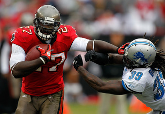TAMPA, FL - DECEMBER 19:  Running back LeGarrette Blount #27 of the Tampa Bay Buccaneers straight-arms safety C.C. Brown #39 of the Detroit Lions during the game at Raymond James Stadium on December 19, 2010 in Tampa, Florida.  (Photo by J. Meric/Getty Im