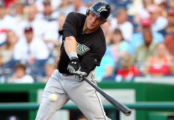 WASHINGTON, DC - JULY 27: Logan Morrison #20 of the Florida Marlins hits the ball against the Washington Nationals at Nationals Park on July 27, 2011 in Washington, DC. The Marlins won 7-5. (Photo by Ned Dishman/Getty Images)