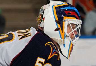 UNIONDALE, NY - MARCH 24:  Goalie Chris Mason #50 of the Atlanta Thrashers waits for a faceoff during an NHL hockey game against the New York Islanders at the Nassau Coliseum on March 24, 2011 in Uniondale, New York.  (Photo by Paul Bereswill/Getty Images