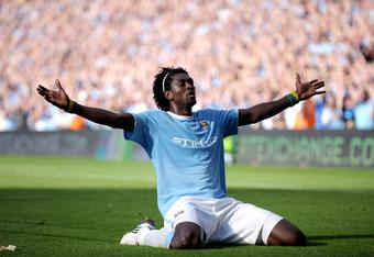 Adebayor after scoring for Man City against Arsenal in Emirates