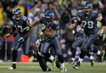 SEATTLE, WA - JANUARY 08:  Running back Marshawn Lynch #24 of the Seattle Seahawks runs for a 67-yard touchdown in the fourth quarter against the New Orleans Saints during the 2011 NFC wild-card playoff game at Qwest Field on January 8, 2011 in Seattle, W