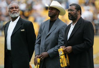 PITTSBURGH - SEPTEMBER 07:  Former members of the Pittsburgh Steelers, L.C. Greenwood (L), Mel Blount, and 'Mean' Joe Greene (R) before a game against the Houston Texans on September 7, 2008 at Heinz Field in Pittsburgh, Pennsylvania.  (Photo by Ronald Ma