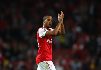 LONDON, ENGLAND - AUGUST 16:  Theo Walcott of Arsenal applauds the fans after the UEFA Champions League play-off first leg match between Arsenal and Udinese at the Emirates Stadium on August 16, 2011 in London, England.  (Photo by Julian Finney/Getty Images)