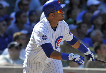 CHICAGO, IL - AUGUST 11: Aramis Ramirez #16 of the Chicago Cubs hits a two-run home run in the seventh inning against the Washington Nationals on August 11, 2011 at Wrigley Field in Chicago, Illinois.  (Photo by David Banks/Getty Images)