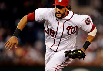 WASHINGTON, DC - AUGUST 22: Michael Morse #38 of the Washington Nationals runs to make a play at first base against the Arizona Diamondbacks in the third inning at Nationals Park on August 22, 2011 in Washington, DC. The Washington Nationals won, 4-1. (Photo by Patrick Smith/Getty Images)