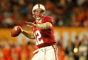 MIAMI, FL - JANUARY 03: Andrew Luck #12 of the Stanford Cardinal throws a pass against the Virginia Tech Hokies during the 2011 Discover Orange Bowl at Sun Life Stadium on January 3, 2011 in Miami, Florida. (Photo by Mike Ehrmann/Getty Images)