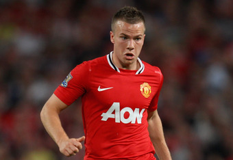 MANCHESTER, ENGLAND - AUGUST 22:  Tom Cleverley of Manchester United with the ball during the Barclays Premier League match between Manchester United and Tottenham Hotspur at Old Trafford on August 22, 2011 in Manchester, England.  (Photo by Alex Livesey/Getty Images)
