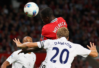 MANCHESTER, ENGLAND - AUGUST 22:  Danny Welbeck of Manchester United heads and scores the opening goal during the Barclays Premier League match between Manchester United and Tottenham Hotspur at Old Trafford on August 22, 2011 in Manchester, England.  (Photo by Alex Livesey/Getty Images)