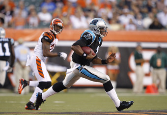 CINCINNATI, OH - AUGUST 25: Cam Newton #1 of the Carolina Panthers breaks free for a 26-yard run in the first half of an NFL preseason game against the Cincinnati Bengals at Paul Brown Stadium on August 25, 2011 in Cincinnati, Ohio. (Photo by Joe Robbins/Getty Images)