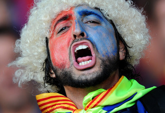 MONACO - AUGUST 26: An FC Barcelona fan cheers with his face painted in the colors of the Catalan club prior to the start of the UEFA Super Cup match between FC Barcelona and FC Porto at Louis II Stadium on August 26, 2011 in Monaco, Monaco.  (Photo by Jasper Juinen/Getty Images)
