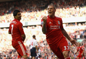 Liverpool's Martin Skrtel (right) celebrates scoring his first goal of the season against Bolton Wanderers as teammate Luis Suarez looks on. (Photo by Clive Brunskill/Getty Images)
