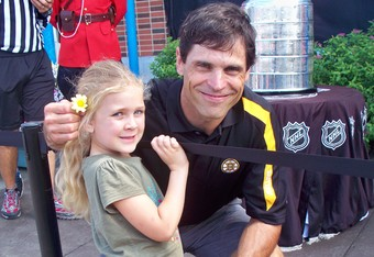 My daughter, Jaiden wanted to give Don Sweeney a flower