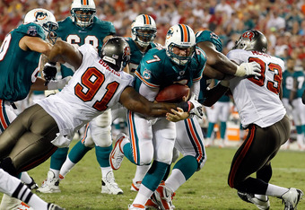 TAMPA, FL - AUGUST 27:  Quarterback Chad Henne #7 of the Miami Dolphins is tackled by defender Da'Quan Bowers #91 of the Tampa Bay Buccaneers during a preseason game at Raymond James Stadium on August 27, 2011 in Tampa, Florida.  (Photo by J. Meric/Getty Images)