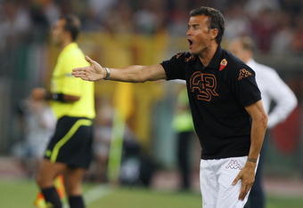 ROME, ITALY - AUGUST 25:  Luis Enrique, the coach of AS Roma, reacts during the UEFA Europa League playoff second leg match between AS Roma and SK Slovan Bratislava at Olimpico Stadium on August 25, 2011 in Rome, Italy.  (Photo by Paolo Bruno/Getty Images)