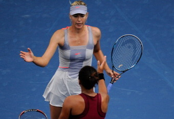 NEW YORK, NY - AUGUST 29:  Maria Sharapova (TOP) of Russia shakes hands after defeating Heather Watson of Great Britian during Day One of the 2011 US Open at the USTA Billie Jean King National Tennis Center on August 29, 2011 in the Flushing neighborhood