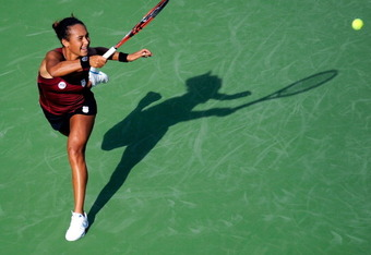 NEW YORK, NY - AUGUST 29:  Heather Watson of Great Britain returns the ball against Maria Sharapova of Russia during Day One of the 2011 US Open at the USTA Billie Jean King National Tennis Center on August 29, 2011 in the Flushing neighborhood of the Que