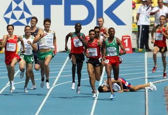 DAEGU, SOUTH KOREA - AUGUST 30:  Mekonnen Gebremedhin of Ethiopia leads as Mehdi Baala of France falls during the men's 1500 metres heats during day four of the 13th IAAF World Athletics Championships at the Daegu Stadium on August 30, 2011 in Daegu, Sout