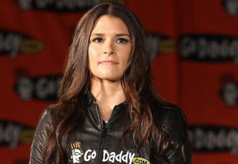 SCOTTSDALE, AZ - AUGUST 25:  Danica Patrick poses with the #7 GoDaddy.com Chevrolet at a press conference to announce her full transition to NASCAR at the GoDaddy.com Headquarters on August 25, 2011 in Scottsdale, Arizona.  (Photo by Christian Petersen/Ge