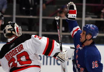 NEW YORK - APRIL 13: Sean Avery #16 of the New York Rangers tries to screen Martin Brodeur #30 of the New Jersey Devils during game three of the 2008 NHL Eastern Conference Quarterfinals on April 13, 2008 at Madison Square Garden in New York City.  (Photo