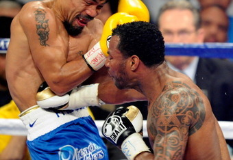 LAS VEGAS, NV - MAY 07:  Shane Mosley (R) hits Manny Pacquiao in the fifth round of their WBO welterweight title fight at the MGM Grand Garden Arena May 7, 2011 in Las Vegas, Nevada. Pacquiao retained his title with a unanimous-decision victory.  (Photo b