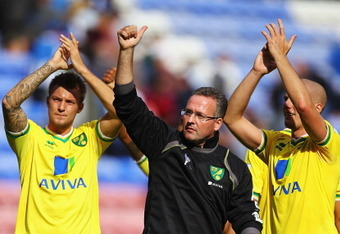Norwich manager Paul Lambert and the team salute the fans after their first game of the season