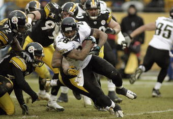PITTSBURGH - DECEMBER 16: Fred Taylor #28 of the Jacksonville Jaguars carries the ball against the Pittsburgh Steelers at Heinz Field December 16, 2007 in Pittsburgh, Pennsylvania. The Jaguars won 29-22. (Photo by Rick Stewart/Getty Images)
