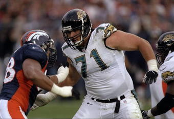 25 Oct 1998:  Tony Boselli #71 of the Jacksonville Jaguars pushes Maa Tanuvasa #98 of  the Denver Broncos at Mile High Stadium in Denver, Colorado. The Broncos defeated the Jaguars 37- 24. Mandatory Credit: Stephen Dunn  /Allsport