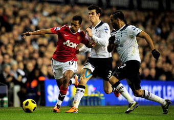 LONDON, ENGLAND - JANUARY 16:  Luis Nani of Manchester United is challenged by Gareth Bale and Benoit Assou-Ekotto of Spurs during the Barclays Premier League match between Tottenham Hotspur and Manchester United at White Hart Lane on January 16, 2011 in