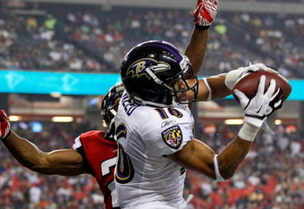 ATLANTA, GA - SEPTEMBER 01:   David Reed #16 of the Baltimore Ravens pulls in this reception against Chris Owens #21 of the Atlanta Falcons before Reed was called for offensive pass interference at Georgia Dome on September 1, 2011 in Atlanta, Georgia.  (