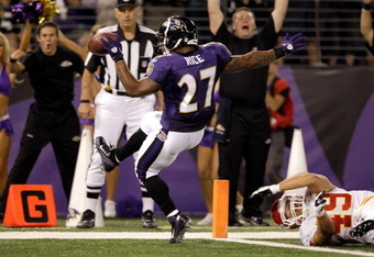 BALTIMORE, MD - AUGUST 19: Running back Ray Rice #27 of the Baltimore Ravens scores a touchdown in front of safety Sabby Piscitelli #49 of the Kansas City Chiefs during the first half of a preseason game at M&T Bank Stadium on August 19, 2011 in Baltimore
