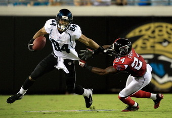 JACKSONVILLE, FL - AUGUST 19:  Cecil Shorts III #84 of the Jacksonville Jaguars attempts to run for yardage following a reception against Dominique Franks #24 of the Atlanta Falcons during a game at EverBank Field on August 19, 2011 in Jacksonville, Flori