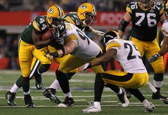 ARLINGTON, TX - FEBRUARY 06:  James Starks #44 of the Green Bay Packers runs for eight-yards against the Pittsburgh Steelers during the first quarter of Super Bowl XLV at Cowboys Stadium on February 6, 2011 in Arlington, Texas.  (Photo by Doug Pensinger/G