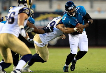 JACKSONVILLE, FL - SEPTEMBER 01:  C.J. Ah You #99 of the St. Louis Rams tackles David Garrard #9 of the Jacksonville Jaguars during a game at EverBank Field on September 1, 2011 in Jacksonville, Florida.  (Photo by Sam Greenwood/Getty Images)
